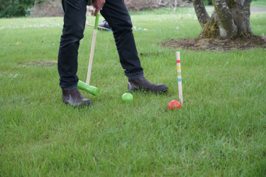 trying out the croquet set