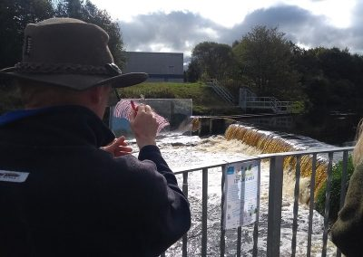 Drawing on perspex to create a record of how the river travels over the weir and fish pass
